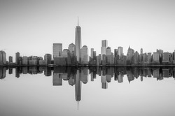 Manhattan Skyline with the One World Trade Center building at twilight, New York City in black and white