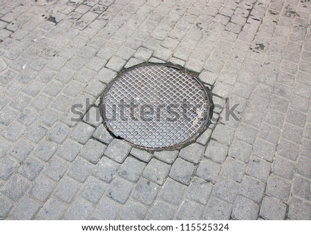 Manhole cover on the street close up.