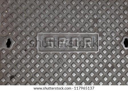 Manhole cover with the inscription S.P.Q.R, Rome, Italy. S.P.Q.R is Roman Empire Symbol (Senatus Populusque Romanus)