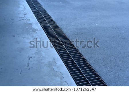 Manhole  (gutter) covering with steel in the parking building #1371262547