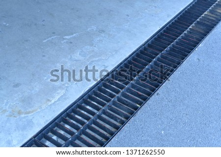 Manhole  (gutter) covering with steel in the parking building #1371262550