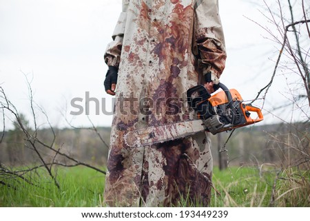 Maniac with the chainsaw dressed in a dirty bloody raincoat.