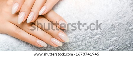 Manicure and Hands Spa. Beautiful Woman hands closeup. Manicured nails and Soft hands skin wide banner. Beauty treatment. Beautiful woman's nails with beautiful baby boomer manicure copy space for