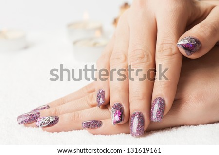 Manicure - Beautiful Manicured Woman\'S Nails With Glitter Purple Gel Nail Polish On Soft White Towel. Selective Focus.