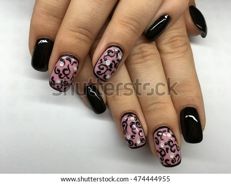 Manicure - Beauty treatment photo of nice manicured woman fingernails #474444955