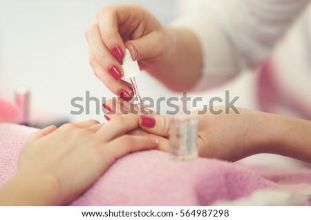 Manicure in beauty salon.