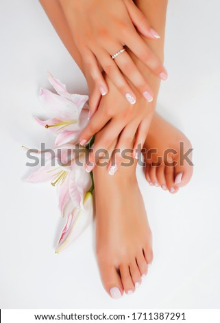 manicure pedicure with flower lily closeup isolated on white perfect shape hands spa salon Stock photo ©