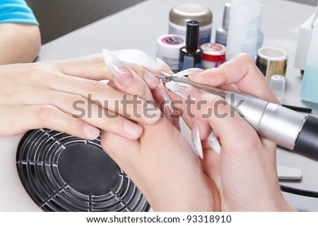 Manicure. The device removes the cuticle