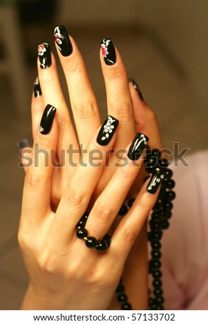 manicure with black nails - stock photo