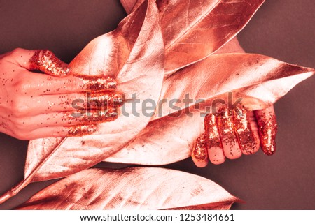 Manicure with glittering fingers. Art fashion inspired by Living Coral - colot of the Year 2019. #1253484661