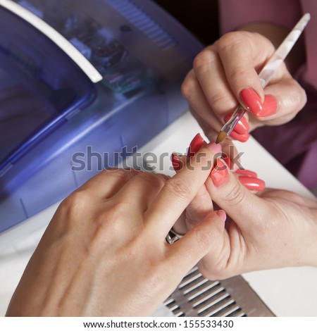 manicurist working with woman nails #155533430