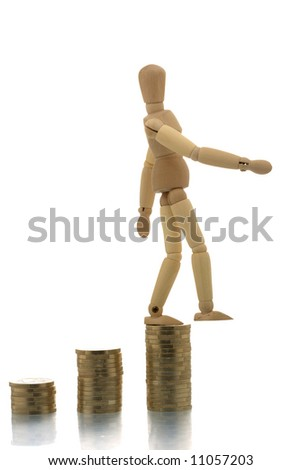 Manikin falling off three coin piles