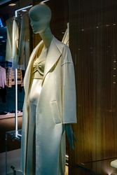 manikin in fashionable women's clothes in a shop window