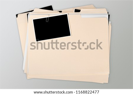Manila folder with some documents in it. on background #1168822477