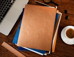 Manila folders on desk