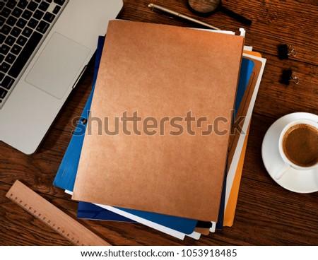 Manila folders on desk #1053918485