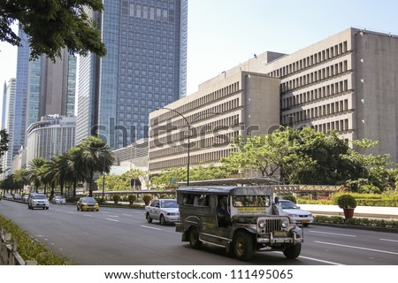 MANILA - MAY 01: traffic on Ayala Avenue on May 01, 2011 in Manila, Philippines. Ayala Avenue is one of Manilas busiest roads, lined by offices it was built on top of the original airport runway