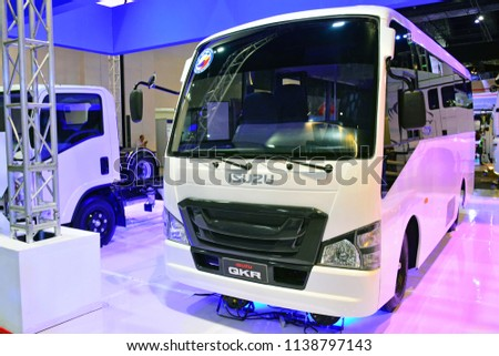 MANILA, PH - JULY 15: Isuzu QKR shuttle bus on July 15, 2018 at Philippines Bus and Truck Show in Manila, Philippines. Isuzu brand is a manufacturer of bus and truck vehicles in Japan. #1138797143