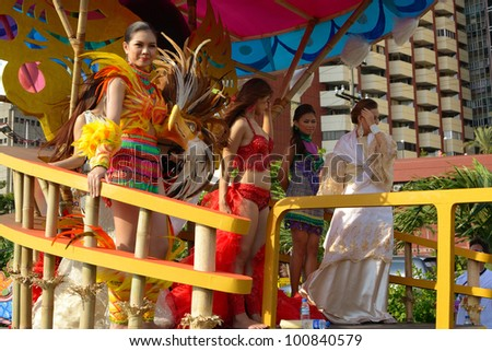 MANILA, PHILIPPINES - APR. 14: beauty contestants in their cultural dresses during Aliwan Fiesta, which is the biggest annual national festival competition on April 14, 2012 in Manila Philippines.