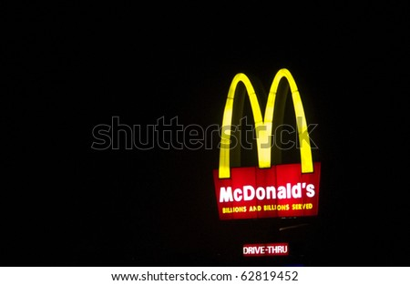 "MANILA, PHILIPPINES - CIRCA 2010: a big mcdonalds sign board with a tag ''billions and billions served"" circa 2010 in Manila, Philippines. Philippines is another fastfood nation. - stock photo"