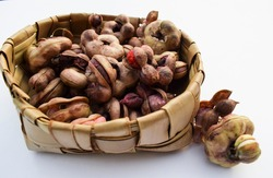 Manila tamaraind also known as chichbila or jungle jalebi, asian or african wild pink raw fruit with seeds. Round shaped tamarind like fruit.