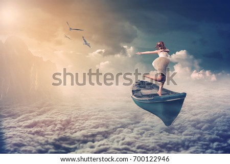 manipulation photo of woman dancing on the boat that fly over the clouds, fantasy and dream emotion