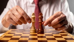Manipulator control fight between two opponents, chess board.