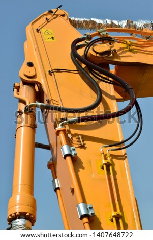 Hydraulic hoses to a construction equipment / Hydraulic hoses Images
