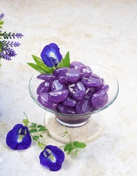 Manisan Kolang Kaling Ungu, or preserved sugar palm fruit added to tinted blue pea flower, sugar and pandan leaves. An Indonesian typical dessert during Ramadan month and in Ied Al-Fitr or Hari Raya.