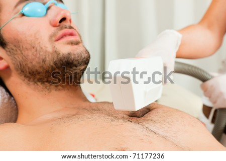 Mann receiving waxing in a Day Spa; for relaxation he wears specs