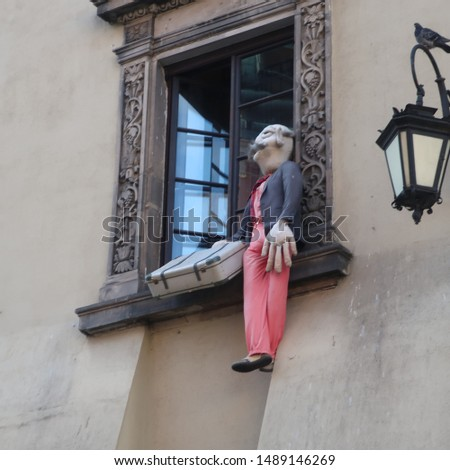 Mannequin doll in a windowsill