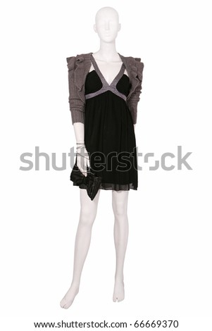 Mannequin dressed in sweater and little black dress