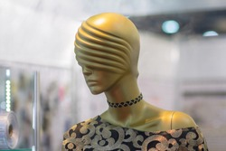 Mannequin female in dress in shop. Fashion