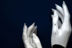 Mannequin hands on a blue background. Art model for drawing. Part of the body - hand, brush. Mannequin for displaying clothes, jewelry. Mannequin for the artist. Color of the year 2020 classic blue.