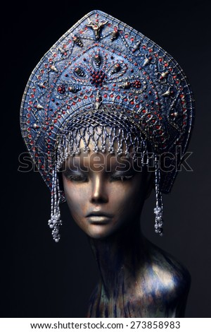 Mannequin in blue headress with beads