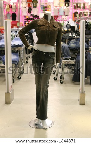 Mannequin in front of a womans fashion store