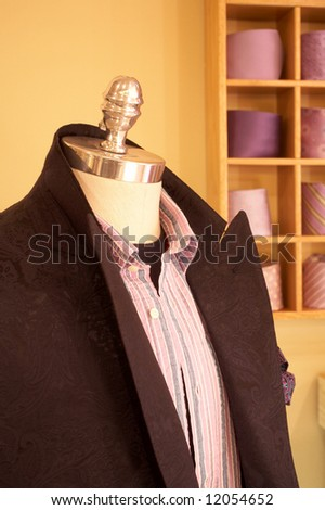 Mannequin in interior of upscale men s clothing store