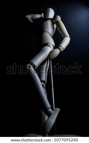 mannequin posing with black background and different poses with a light late and in low key #1077095240