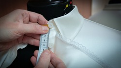 mannequin with a blouse in a sewing studio, hands with a hands w