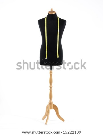 Mannequin with a tape measure a over white background