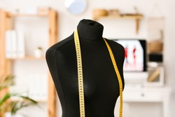 Mannequin with measuring tape in atelier