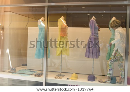 Mannequins at a window display women s fashion - stock photo