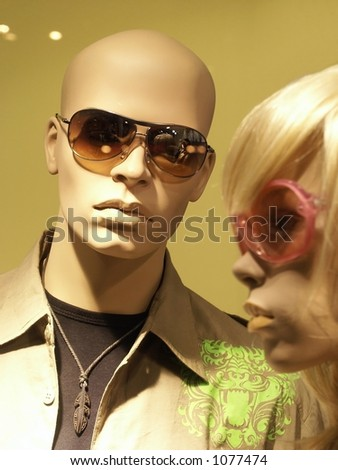 Mannequins in store with clothes. Man & Woman, focus on Man.