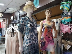 Mannequins in the store. Female mannequins in dresses.