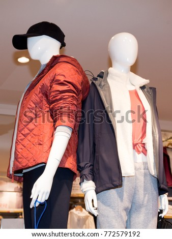 Mannequins men to present clothes in the showcase #772579192