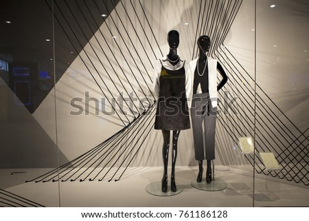 mannequins standing in the shop window Display casual woman clothing store in the Mall #761186128