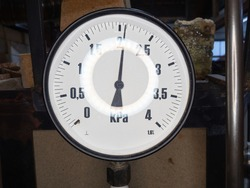Manometers showing gass pressure in faucet valves of heating system in a boiler room. Strong light circle
