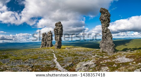 Manpupuner rock formations. А set of 7 stone pillars located west of the Ural mountains in the Troitsko-Pechorsky District of the Komi Republic Сток-фото ©