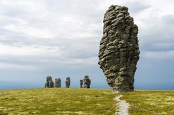 Manpupuner rock formations. Weathered stone pillars. Famous nature landmark of Ural mountains, Komi Republic, Russia. Travel destination landscape.