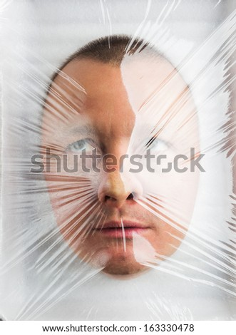 Mans head in Wrapped plastic white food container